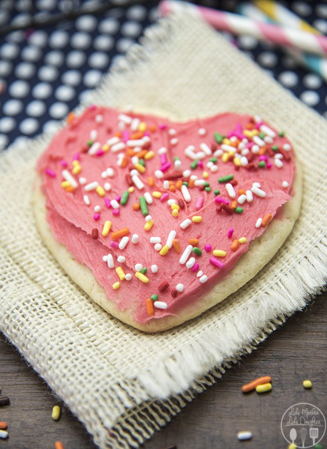 Sugar Cookies - These are the best sugar cookies ever! They're perfect soft and topped with an amazing vanilla frosting!