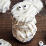 A stack of Oreos dipped in white chocolate to look like mummies.