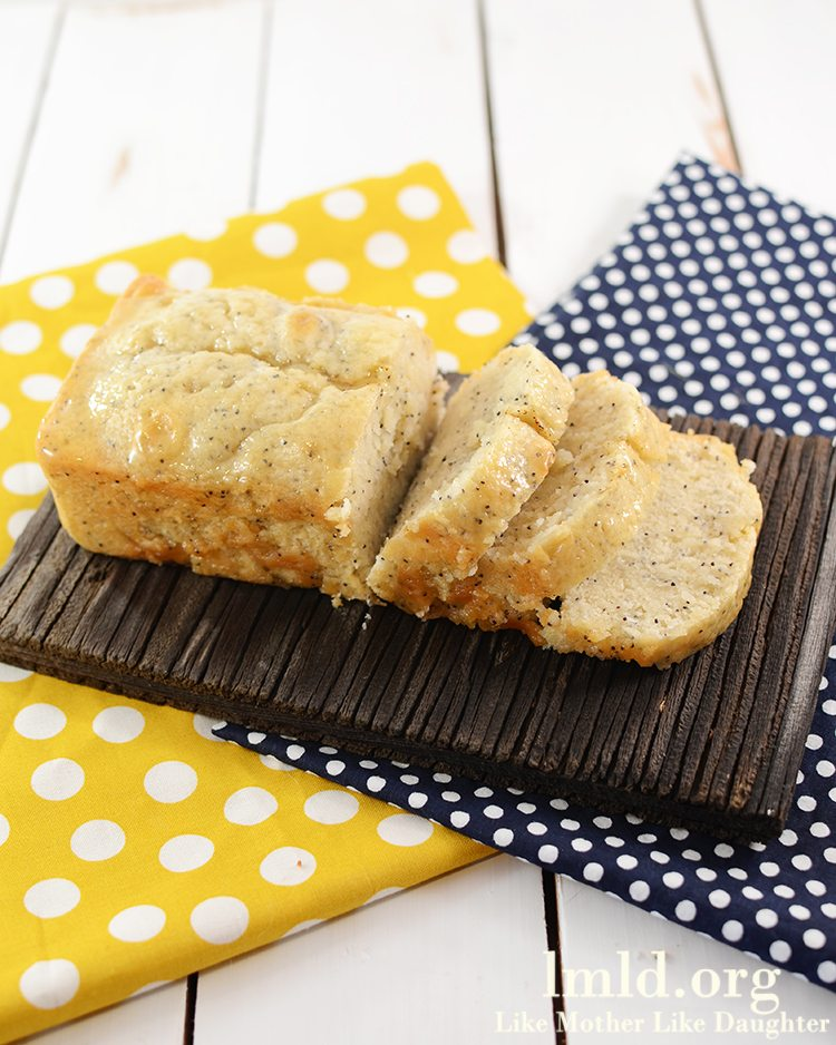 Glazed Lemon Poppy Seed Bread - This delicious sweet bread is moist, and covered in a delicious orange glaze for a perfect dessert