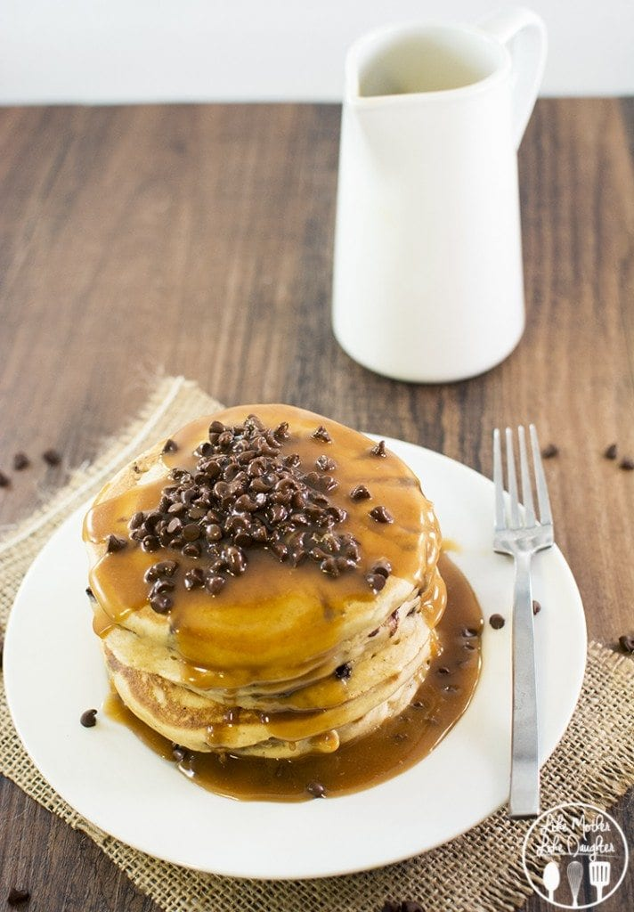Peanut Butter Chocolate Chip Pancakes - the perfect breakfast for all you peanut butter lovers out there. Topped with an amazing and simple peanut butter syrup!