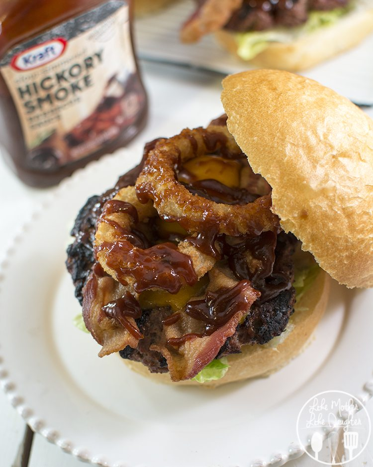 Western Bacon Cheeseburger - This thick and delicious juicy burger is perfect when topped with cheddar cheese, crispy bacon, onion rings and Kraft Hickory Smoke Barbecue Sauce! Its better than anything you'd get at a burger joint or fast food restaurant.