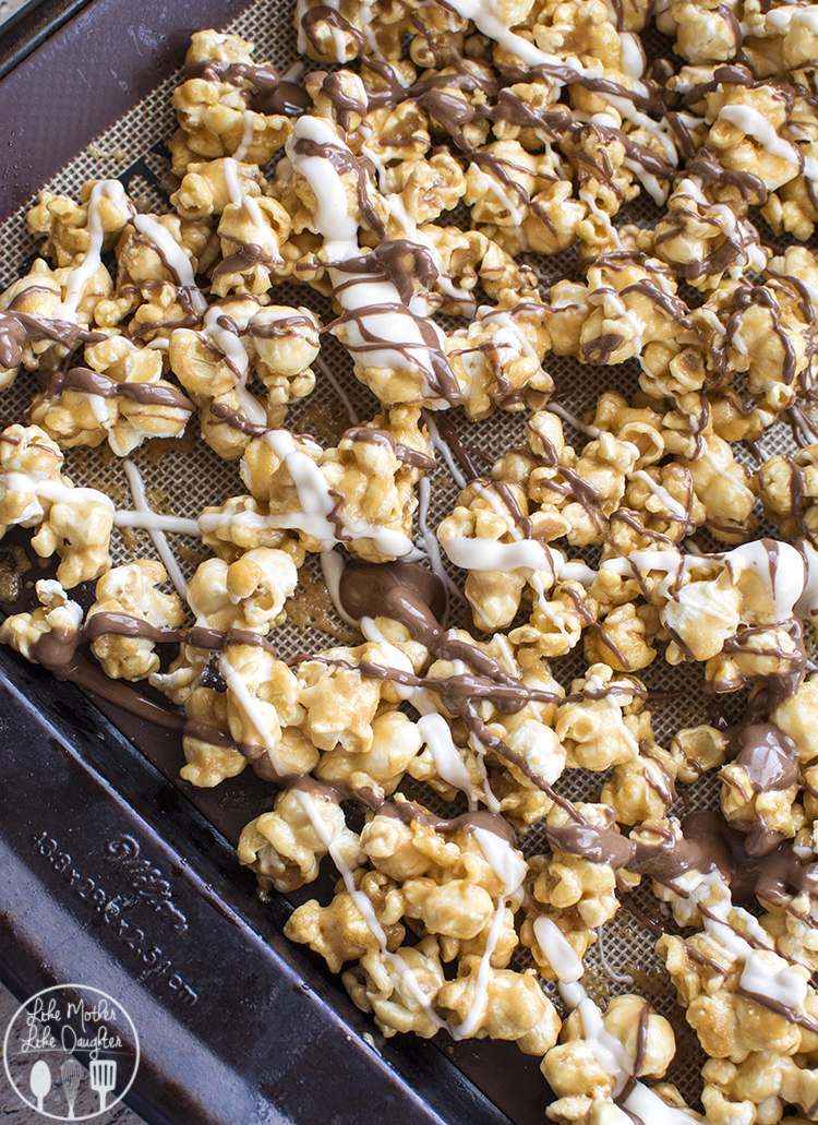 Zebra Caramel Popcorn - a delicious homemade crunchy caramel popcorn drizzled with white and milk chocolate for the perfect snack or treat!