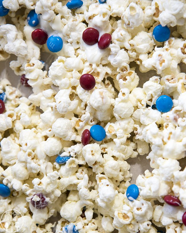 Patriotic White Chocolate Popcorn - This delicious white chocolate popcorn is simple to make, and tossed with red and blue m&ms for a simple red white and blue treat!
