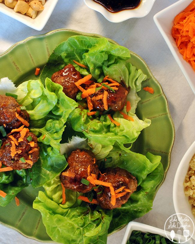 Asian Meatball Lettuce Wraps -  a spicy meatball with an Asian flare eaten with lettuce wraps and garnished with shredded carrots and minced green onions served with a side of quinoa