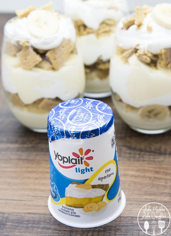 Banana Cream Pie Yogurt Parfait - These parfaits have layers of banana cream pie yogurt, whipped cream, fresh bananas and graham crackers for the same great flavors of banana cream pie, just a little lighter. These are the perfect afternoon snack or late night treat.
