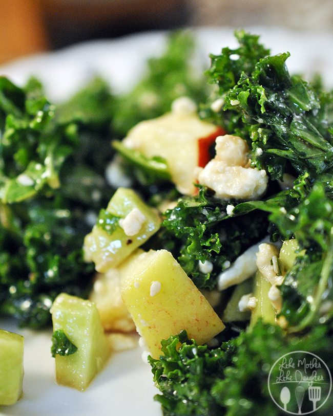 Kale Sesame Salad - this kale salad is a tasty way to eat to your health. Kale, cucumbers, green apples, feta cheese, sesame seeds with a honey vinaigrette all tossed together for deliciousness and healthiness.