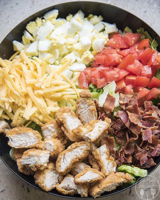 Chicken cobb salad is going to be your new favorite lunch! Its packed full of flavor and so easy to make!