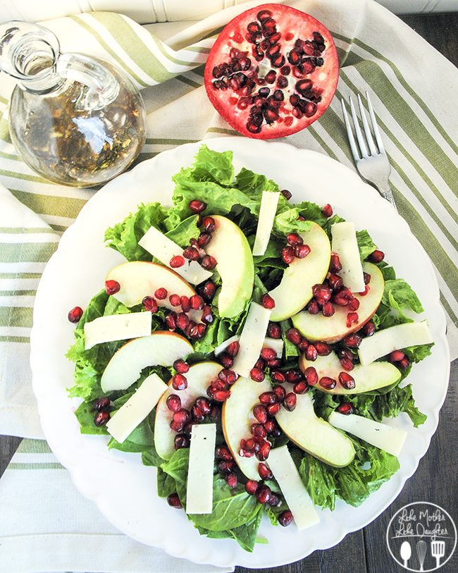 Pomegranate Fall Salad -  fresh green salad with spinach leaves, sliced apples, pomegranate seeds,  Havarti cheese, dressed with honey balsamic vinaigrette