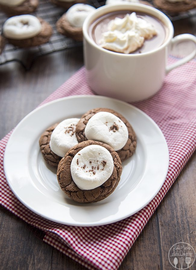 This hot chocolate cookie recipe is perfect for a holiday party! Rich, chocolate cookies topped with more chocolate and a gooey marshmallow!