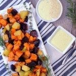 A savory roasted sweet potato flavored with fresh herbs of chives, rosemary, and thyme served with a rosemary garlic aoli sauce