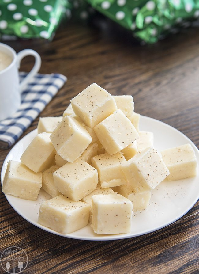 Eggnog Fudge - This smooth and creamy white chocolate eggnog fudge has the great taste of your favorite holiday beverage. Its the perfect holiday candy that everyone loves