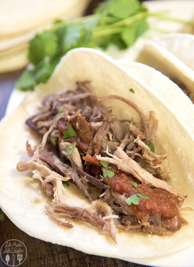 Slow Cooker Pork Carnitas - These deliciously flavored pork carnitas are cooked to perfection in the slow cooker for several hours. Then cooked on the skillet to get that perfect crunch while keeping the meat juicy! Great plain or eaten as tacos!