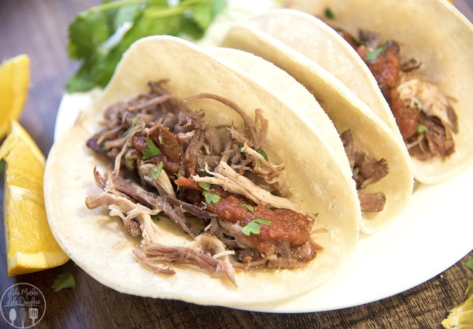 Slow Cooker Pork Carnitas - These deliciously flavored pork carnitas are cooked to perfection in the slow cooker for several hours. Then cooked on the skillet to get that perfect crunch while keeping the meat juicy! Great plain or eaten on tacos!