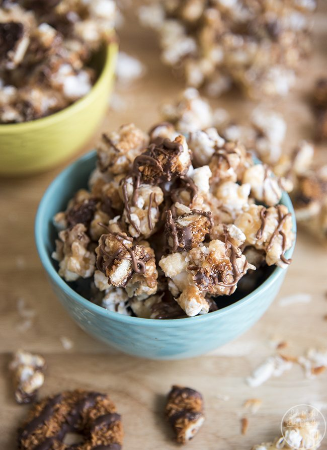 Samoa Popcorn - This amazing samoa popcorn has the same great flavors of Samoas cookies - homemade caramel popcorn packed full of toasted coconut, samoas cookies and all drizzled with chocolate. Perfection in every bite!