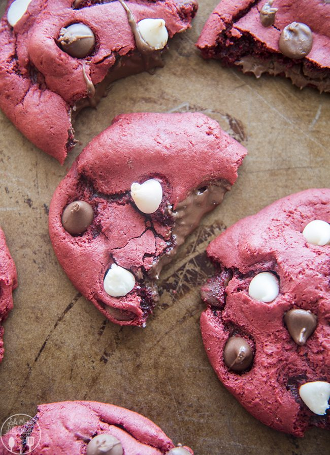 Nutella Stuffed Red Velvet Cookies - These nutella stuffed cookies are delicious cake mix red velvet cookie stuffed full of gooey nutella and chocolate chips. They've got perfectly crispy edges with gooey middles and everyone loves them!