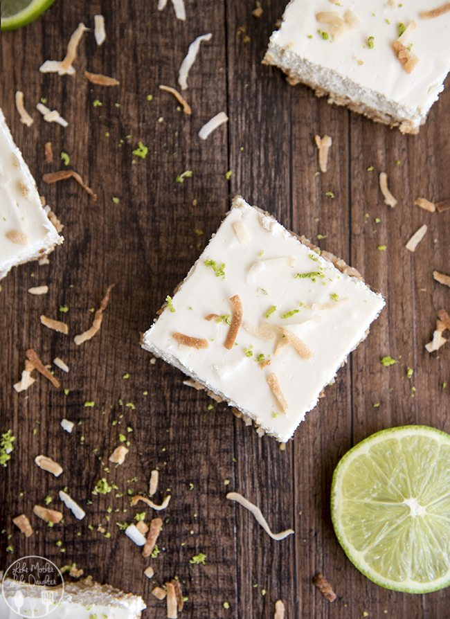 Lime Cheesecake Bars - these light, creamy and tangy cheesecake bars are made lighter with egg whites, Splenda and greek yogurt! They have a coconut graham cracker crust to make them perfectly tropical and delicious!
