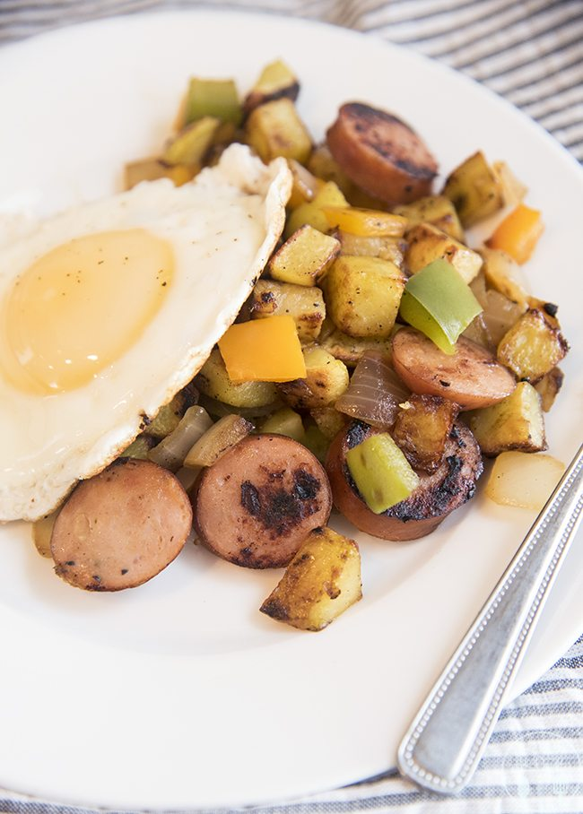 Breakfast hash - this This is a delicious combination of potatoes, peppers, onions, and sausage. Great for breakfast or dinner served with a fried egg on top!