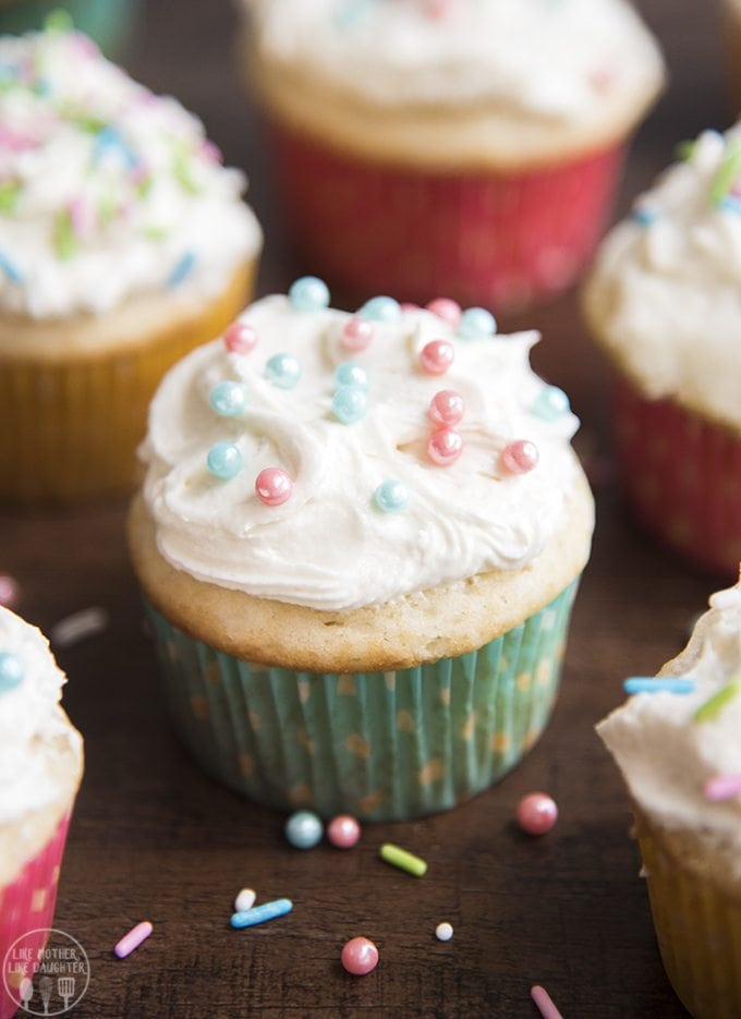 Gender reveal cupcakes are so easy to make, with your favorite cupcake recipe filled with colored m&ms revealing the gender of the baby when you bite right in! Top them with the best thick and creamy homemade buttercream frosting and sprinkles for the perfect gender reveal party dessert!