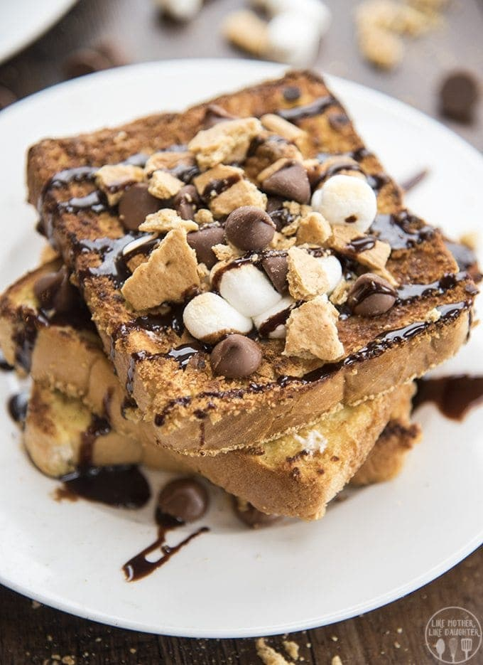 This s'mores french toast is a delicious twist on traditional french toast with a graham cracker crust, topped in toasted marshmallows , chocolate chips and chocolate syrup!