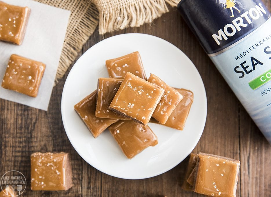 This salted caramel fudge is the best creamy milk chocolate fudge topped with a layer of smooth caramel, sprinkled with coarse sea salt.