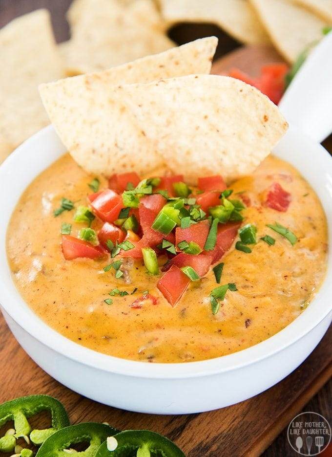 Beef queso dip is creamy cheesy goodness packed with a punch; with seasoned ground beef, velvety smooth cheese and packed full of flavor this dip is the perfect party appetizer!