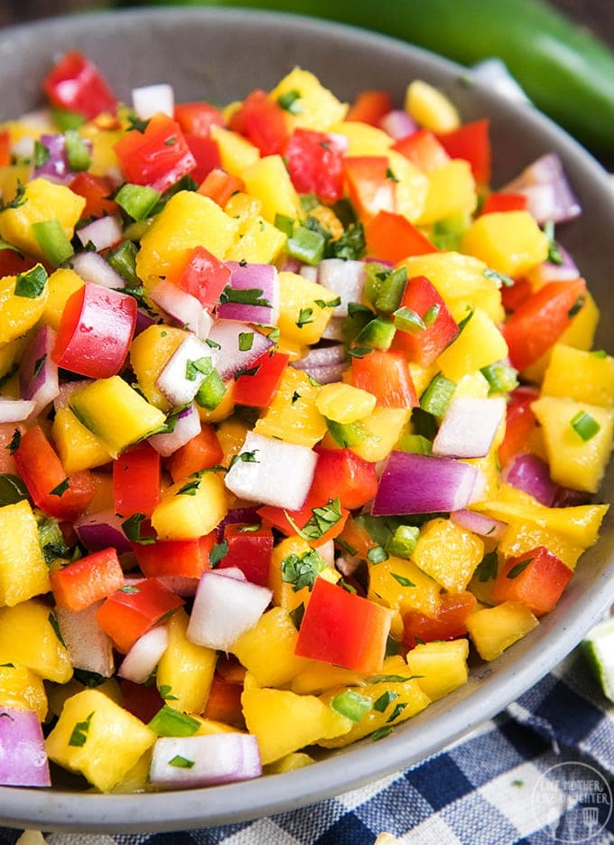 This fresh mango salsa is easy to make, and its so delicious served with chips, on grilled meat, tacos, and more!
