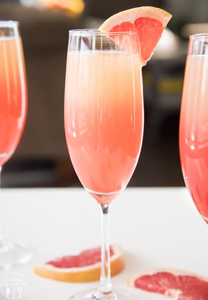 This sunrise grapefruit cocktail is a gorgeous grapefruit mocktail with a splash of grenadine to give it the beautiful coloring.