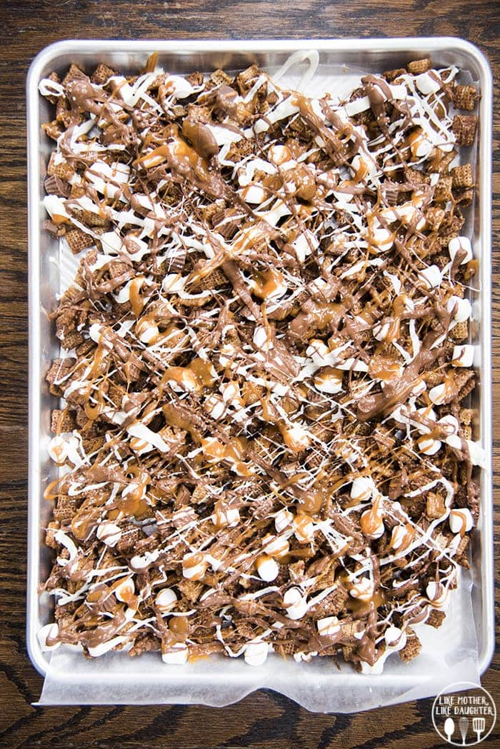 Better than Sex Chocolate Chex mix is an amazing sweet chex mix, with chocolate chex, melted caramel, peanut butter cups, marshmallows, and lots of chocolate!