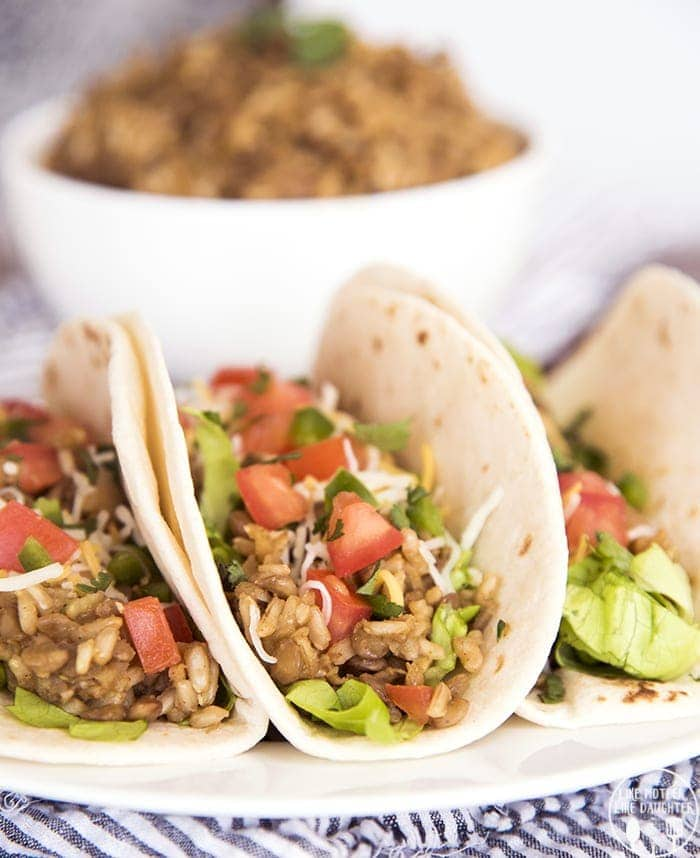 Lentil Tacos make a delicious hearty and flavorful meal that are great for vegetarians and meat eaters alike! Top them with your favorite taco fillings and they will be a family favorite!
