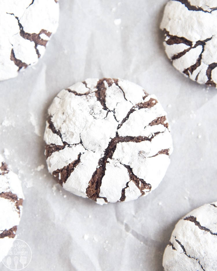 These Chocolate Crinkle Cookies are perfectly soft, fudgy, and so delicious! A classic chocolate cookie coated in powdered sugar, for the perfect holiday cookie.