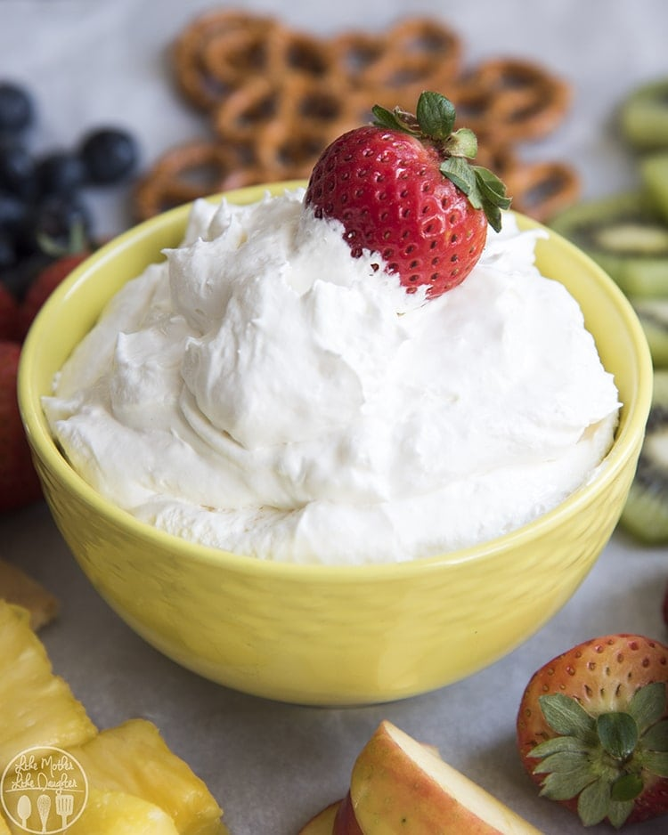 This piña colada fruit dip combines the great piña colada flavors of coconut and pineapple, along with cream cheese and cool whip for a sweet fruit dip, perfect for a snack or serving at a party.